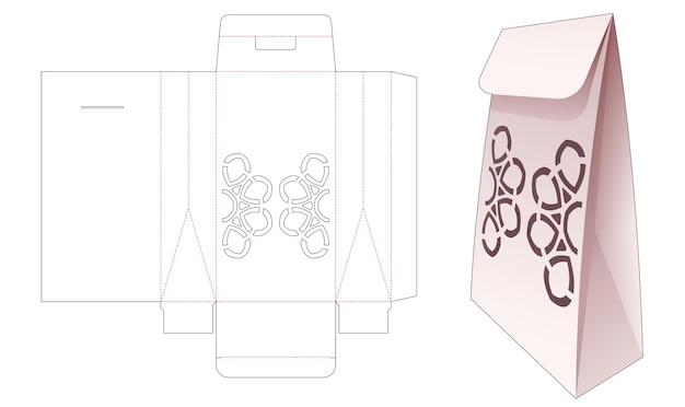 Бумажный пакет с вырезанным по трафарету шаблоном мандалы