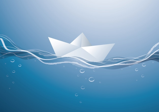 Paper boat on blue water surface