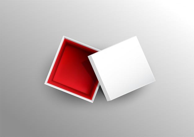 Шаблон бумажной коробки изолированный на предпосылке.