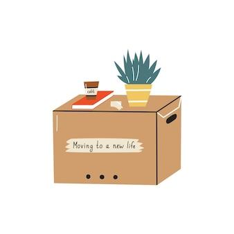다양한 가정 용품이 담긴 종이 판지 상자