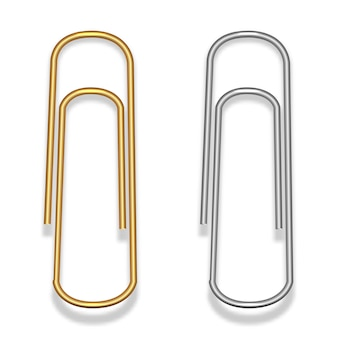 Paper clips made of metal wire in gold and silver colors. stationery.