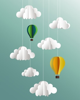 Paper clouds and balloons on blue background