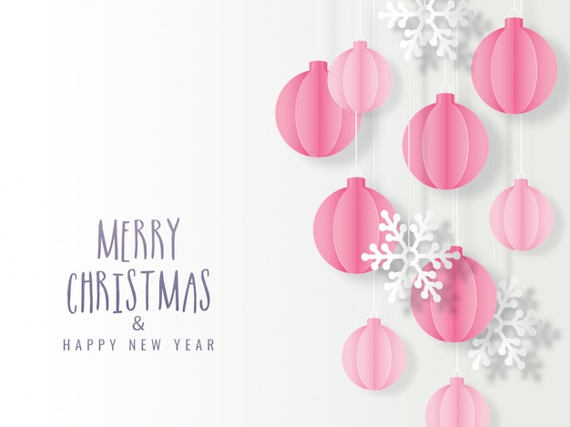 Paper cut baubles hang and snowflake decorated on white background for merry christmas & happy new year celebration