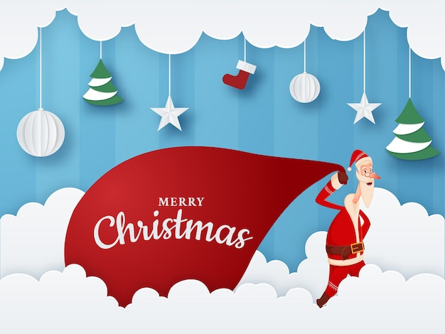 Paper cut clouds and blue striped background decorated with hanging baubles, stars, sock, xmas tree and santa claus pulling a red heavy sack for merry christmas celebration.