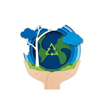 手と環境保全アースデイと世界環境とエコのペーパーカットコンセプト
