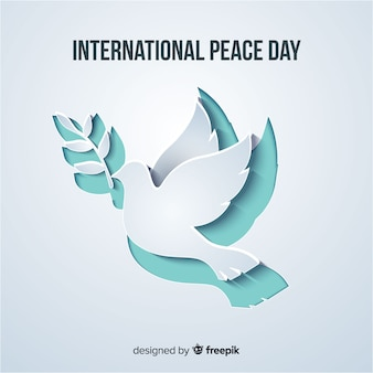 Paper cut dove shape for peace day Premium Vector
