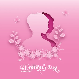 Paper cut female face with flowers, leaves and butterflies on pink background for happy women's day.
