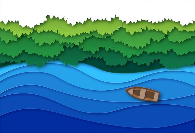 Вырезанная из бумаги река. вид сверху поток воды и зеленый сень деревьев тропического леса. креативный оригами природный воздушный пейзаж