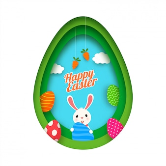 Paper cut style egg shape with cartoon bunny holding printed eggs and carrots