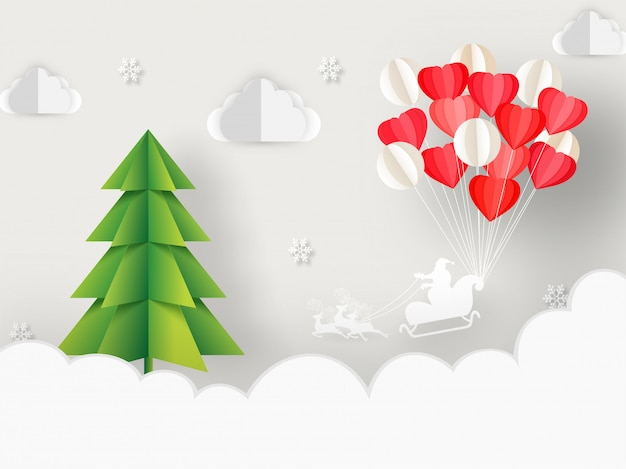 Paper cut style xmas tree, balloon bunch and silhouette santa riding reindeer sleigh on cloudy background