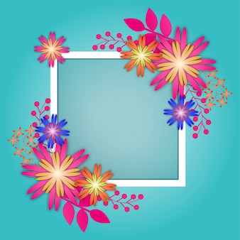 Paper flowers with white square frame on blue background.