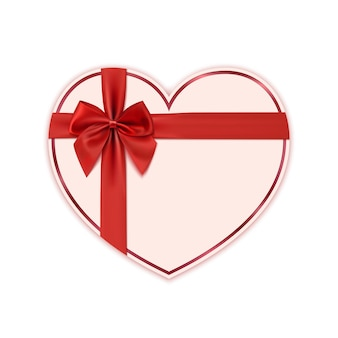 Paper heart with red ribbon and a bow.