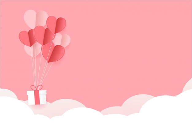 Paper hearts float on pink background. valentine's day