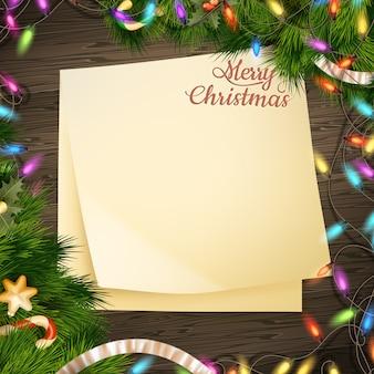休日挨拶メッセージと木製の背景にクリスマスの装飾の紙メモバナー。