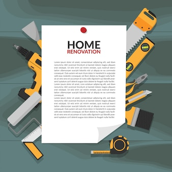 Paper notice banner with headline home renovation pin on wooden board
