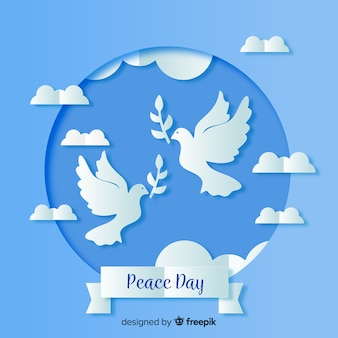 Paper peace day with dove on blue shades