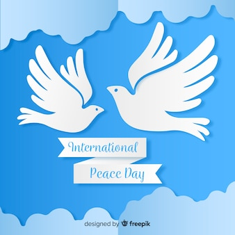 Paper peace day with dove and clouds