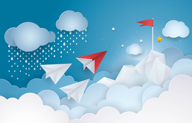 Paper plane flying to the red flag top of a mountain in sky cloud