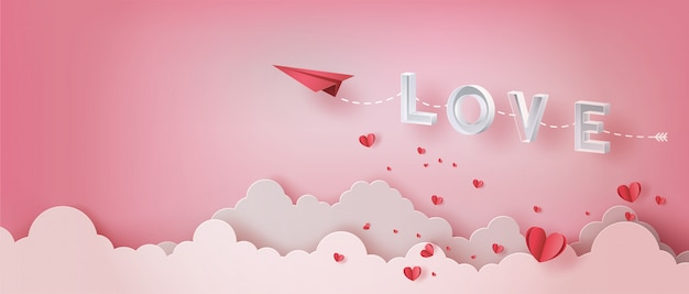 Paper plane flying in the sky with letter love and many hearts floating.