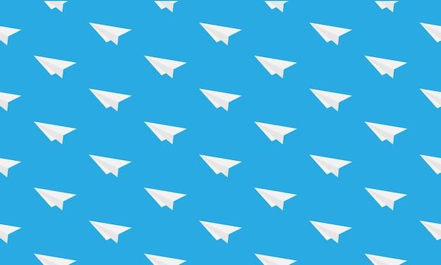 파란색 배경에 고립 된 종이 비행기 원활한 패턴