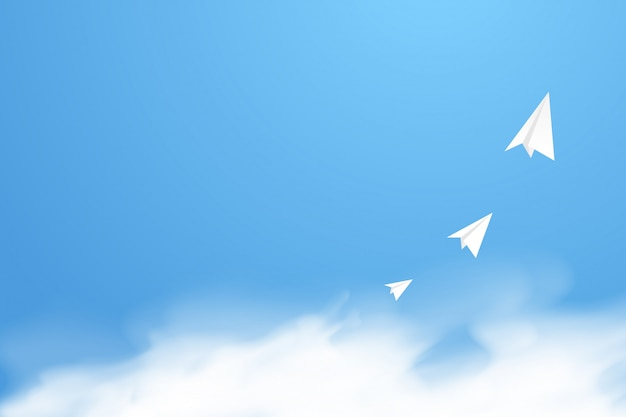 Paper rockets flew in the sky above the smooth fluffy clouds on gradient blue background.
