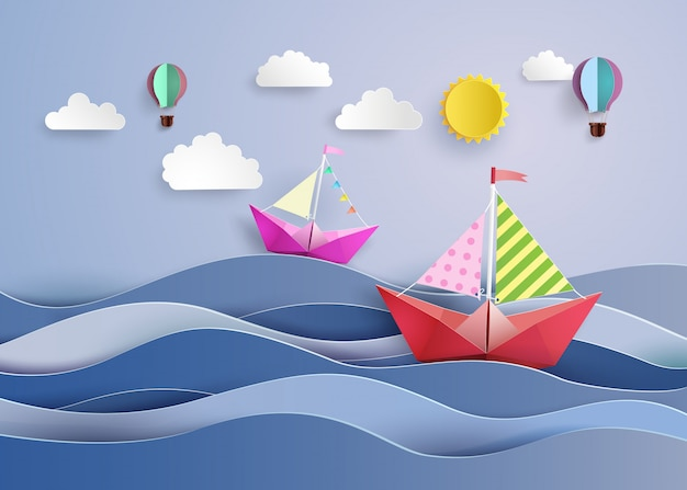 Paper sailing boat and balloon
