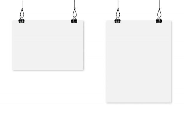 종이 시트 클립에 매달려. 빈 흰색 포스터 템플릿입니다. 광고 배너.