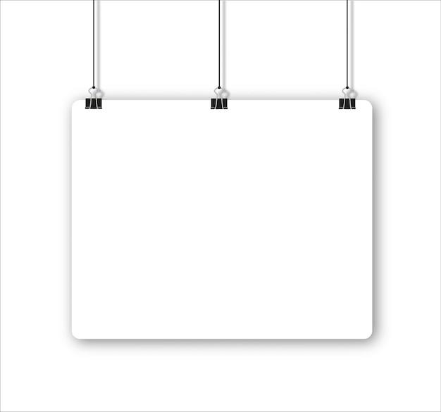 Лист бумаги с тенью в формате и черная скрепка