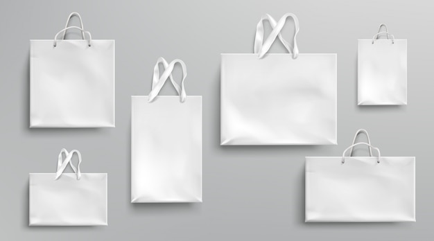 Paper shopping bags mockup, white packages with rope and lace handles, blank rectangular ecological gift packs, isolated mock up for branding and corporate identity design, realistic 3d set