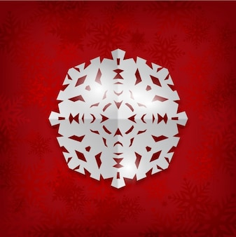 Paper snowflake on a red background
