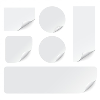 Paper stickers with curled corners on white