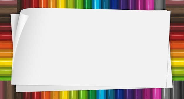 Paper template with color pencils in background