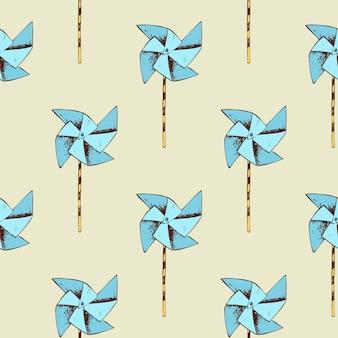 Бумажный образец ветряной мельницы. вертушка игрушка и бесшовный фон.