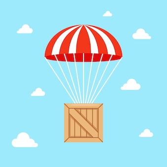 A parachute with a wooden box falls to the ground.