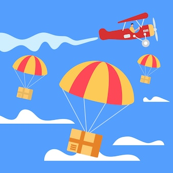 Parachutes with boxes falling down from airplane