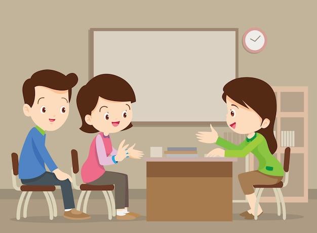 Parent meeting with teacher in classroom