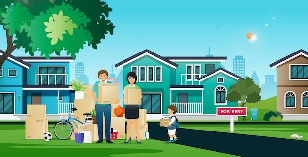 부모와 자녀는 이사 집에서 물건을 옮기는 것을 돕고 있습니다.