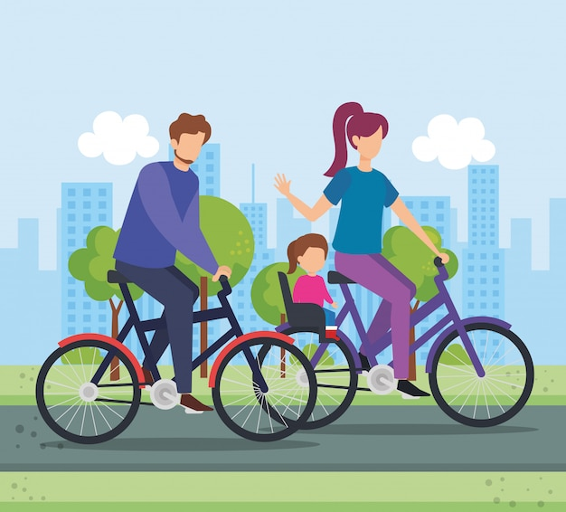 Parents in bicycle with daughter on the park
