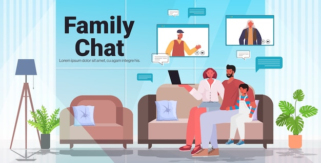 Parents and child having virtual meeting with grandparents in web browser windows during video call family chat communication concept living room interior horizontal copy space