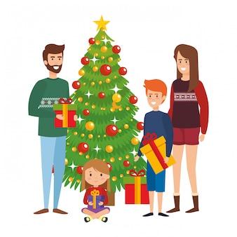 Родители пара с детьми и рождественская елка