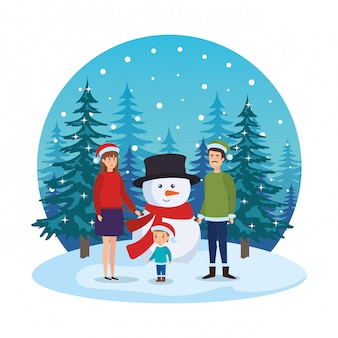 Parents couple with kids and snowman in snowscape