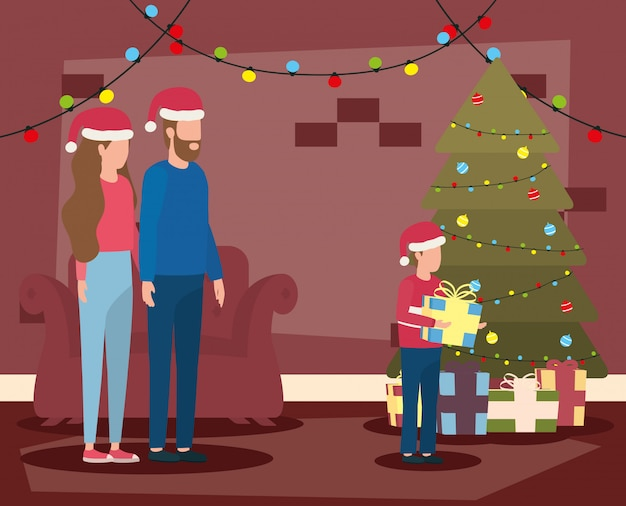 Parents and son celebrating christmas in livingroom with tree