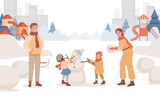 Родители проводят выходные со своими детьми на свежем воздухе в зимнем городском парке