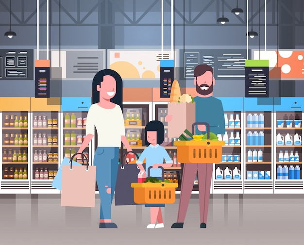 Parents with daughter shopping at supermarket buying fresh grocery products