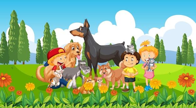 많은 아이들과 애완 동물이있는 공원 야외 장면