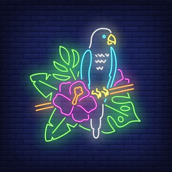 Parrot neon sign. blue tropical bird on blooming twig. glowing banner or billboard elements.