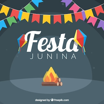 Party background with bonfire and garlands of colors in flat design