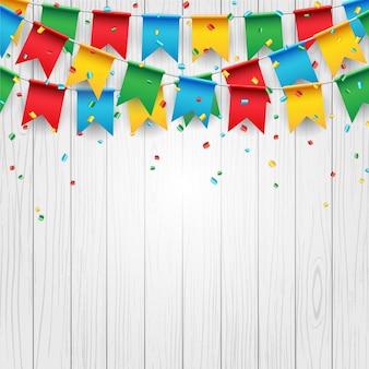 Party celebration flag on white wood background