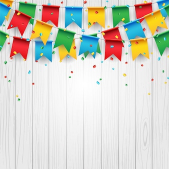 Party celebration flag on white wood background
