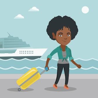 乗客はスーツケースを持ってクルーズ客船に行く